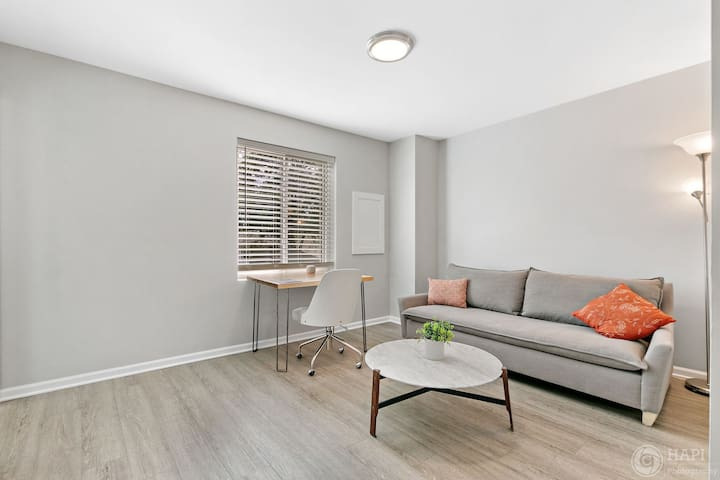 The 3rd bedroom is an office with a desk and chair, as well as a West Elm couch that pulls out to a queen bed. There is an attached full bathroom to this room.