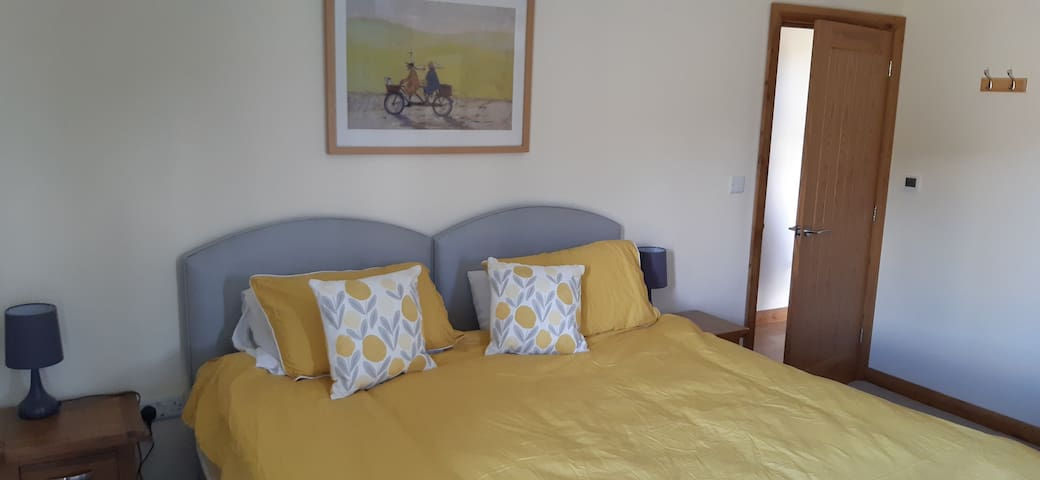 Bedroom 2 - Super King or splits into 2 single beds. Views of surrounding countryside, fields, with sheep in lambing season.