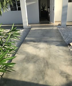 There is a ramp from the sidewalk to the entrance of the home. Also all around the house there is a concrete floor for easy wheelchair accessibility.