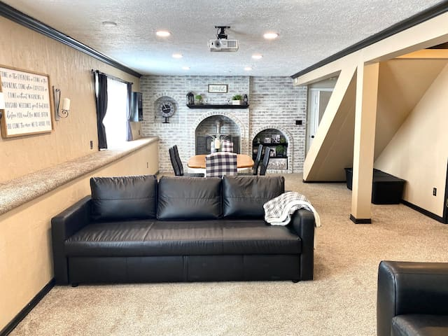Living area, kick back on this extra large couch and watch a movie on the projector. This couch folds out into a queen size bed.