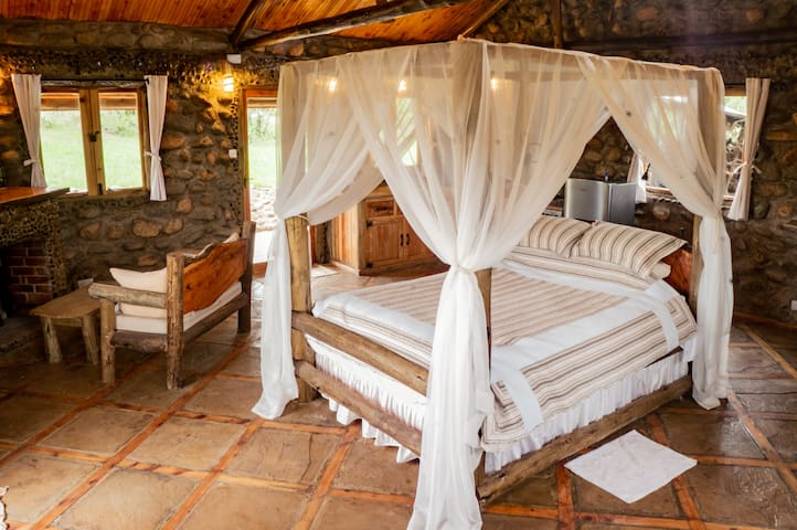 """The custom queen sized canopy-bed has a full length """"intimacy mirror"""" over-head!"""