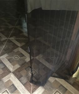 Flat, tiled floors throughout the property.