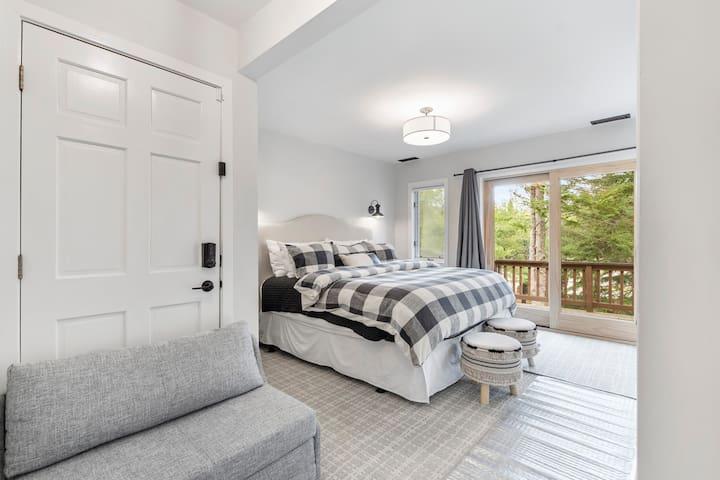 The spacious bedroom features a king-size bed and a plush Kirkland Sealy Signature Series mattress. Everything is new in 2021.  The bed is a Pottery Barn headboard, hotel plush king-size pillows, and fancy bedding.