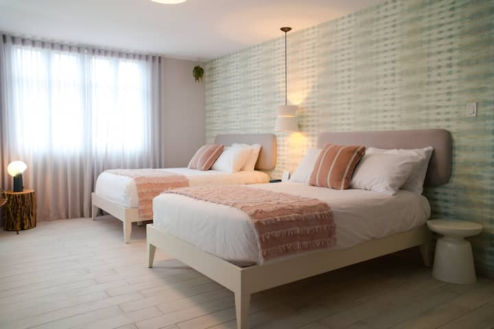 Stylish room equipped with 2 full size beds