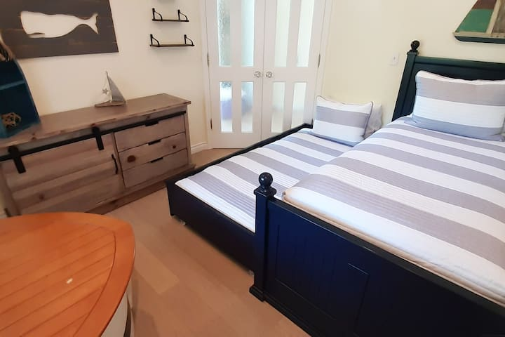 Row Boat bedroom with twin bed and twin trundle.  Located downstairs.