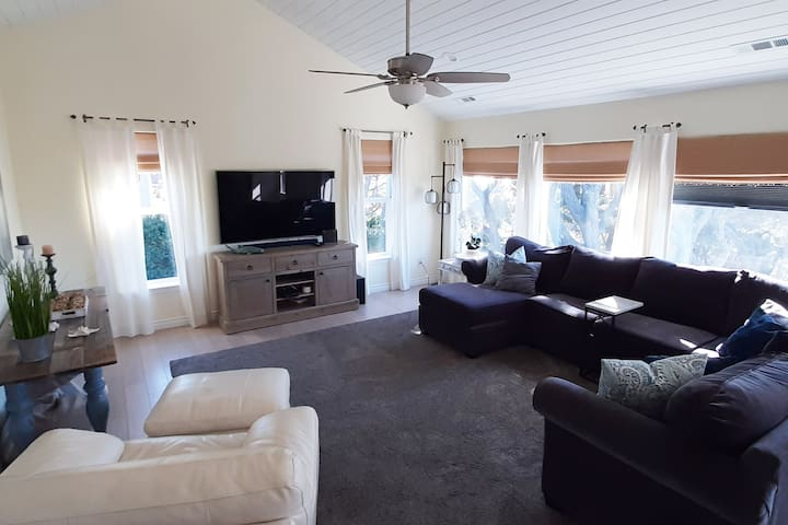 Spacious livingroom with garden and distant ocean views.  Spectrum cable tv and Roku.