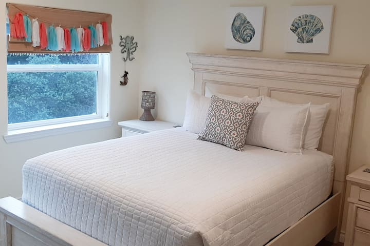 Mermaid bedroom with queen bed.  Located downstairs with private full bathroom and tv with Roku.