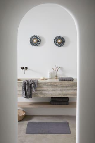 Master bathroom by Parachute.