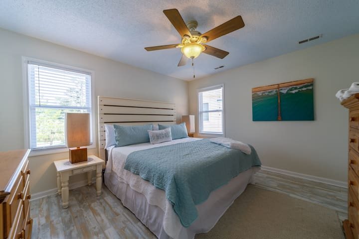 Master Bedroom with a custom headboard and King Bed.