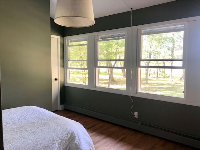 Cozy 4th bedroom with double bed, work desk, and the best views of the lake.
