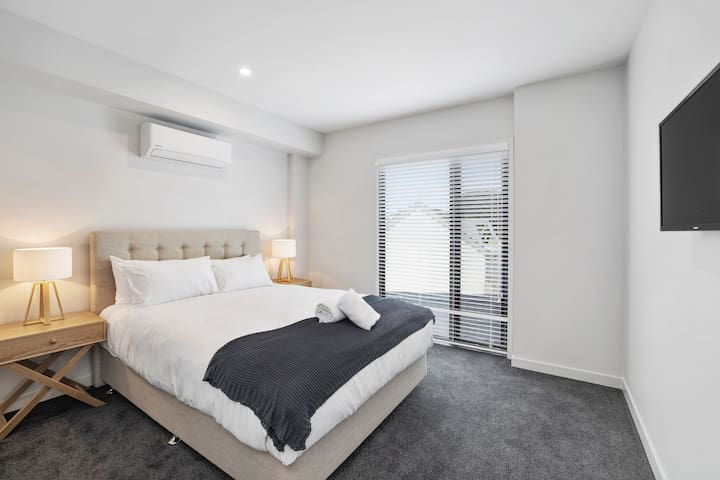 The Master bedroom has a Queen Bed with sunny west outlook, walk-in robe, split system A/C & a Smart TV.