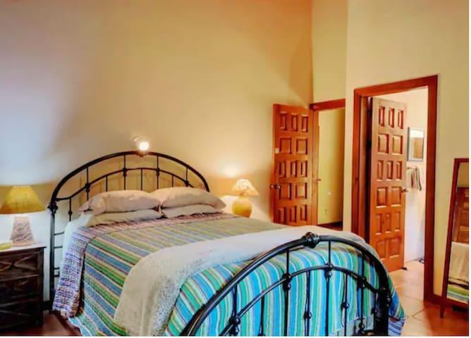Master bedroom. Queen size bed. En-suite bathroom.