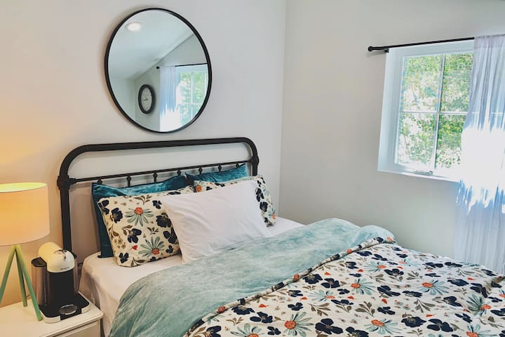 Upper Level Guest Bedroom with Queen bed that looks out to the beautiful home of Aspens abs hummingbirds.