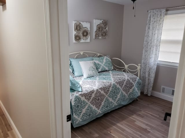 This is the middle bedroom and it has a cute daybed with a trundle bed underneath that rises up when pulled out.