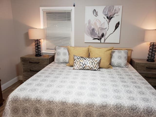 View of our mater bedroom that has a nice comfy king bed with large night stands.