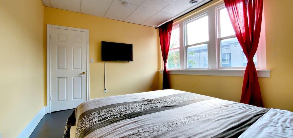 Cozy Queen bed with TV
