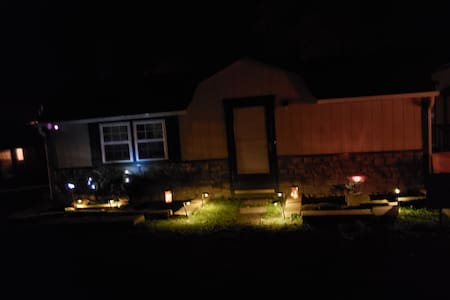 front of Cottage at night