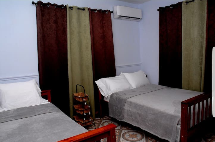 Super comfortable room with air conditioning and closet.