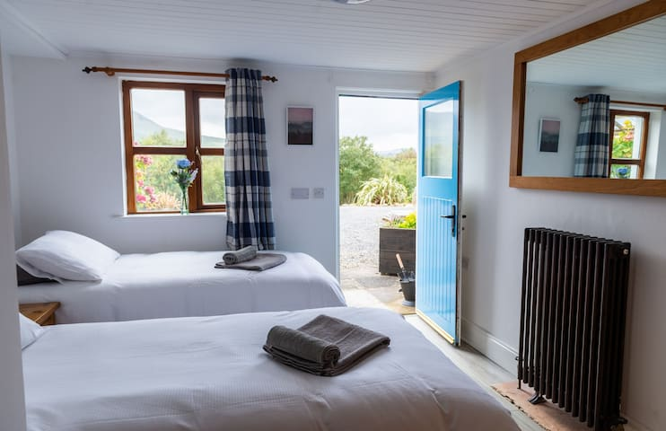 Downstairs bedroom with 2 single beds that can be made into double bed on request . With separate entrance on to courtyard