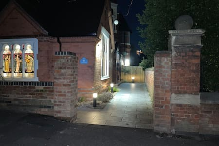 Well-lit path to entrance