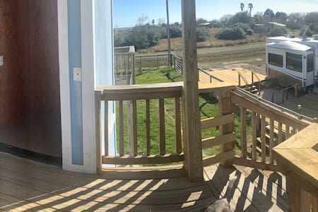 This is a panoramic picture of the back deck where the elevator and back door that is 34 inches wide come together