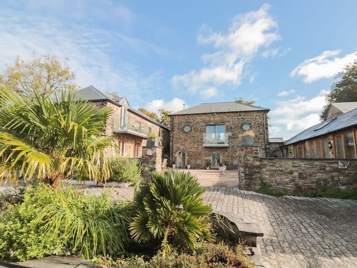 3 luxurious cottages surrounding a stone courtyard