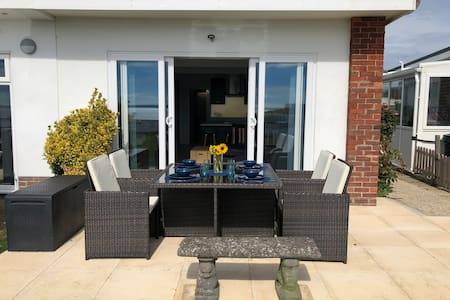 Front patio door with slight lip accessible with slight help via wheelchair or walking frame