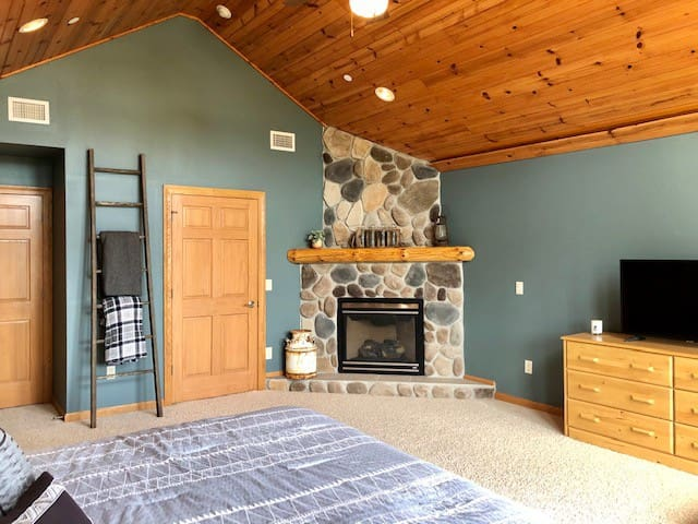 Master bedroom fireplace for cozy nights;  ample dresser space and large walk-in closet.