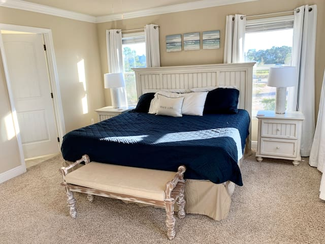 The master bedroom is quite large and has blackout curtains on each window for optimal sleeping conditions.  The king mattress is brand-new.
