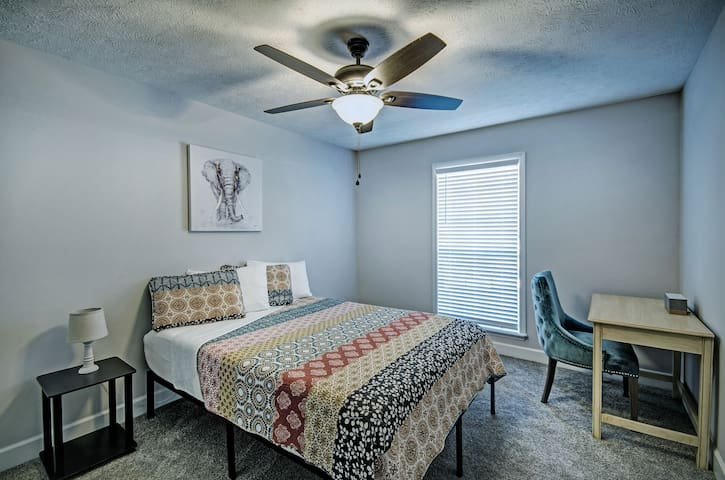 The second bedroom includes a queen memory foam mattress and a desk.