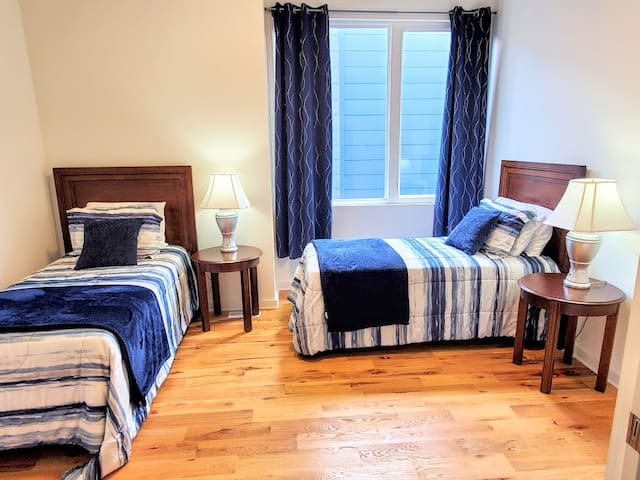 Curl up in one of these twin beds and watch Netflix on the 40 inch television.  Large window provides lots of light, but the blackout curtains provides the darkness needed to sleep late.