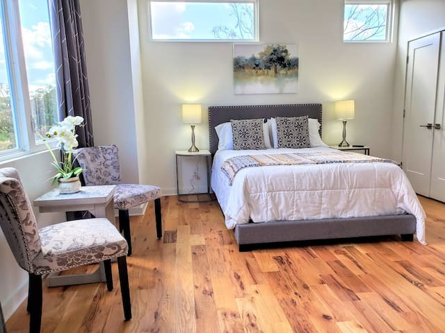 Get comfortable in this large master bedroom with it's own bathroom.  Watch Neflix on the 55 inch television or sit at the table and get some work done on your laptop. Huge windows with black-out curtains.