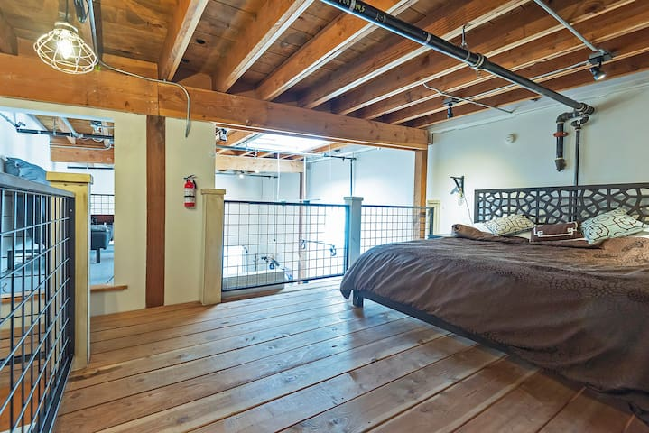 The master bedroom, which has a king sized bed.