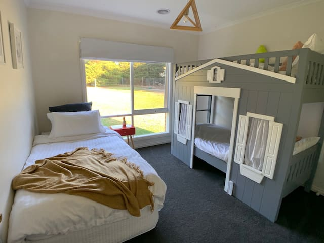 Bedroom 4 - Single Bunk beds and 1 x King Single. The top bunk is recommended for children over 8
