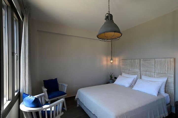 Kefalonia villas with pool: chic 3 bedroom villa in Spartia, Kefalonia, Greece - each bedroom has en suite bathroom.