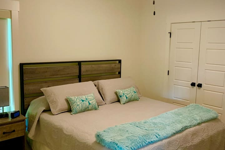 King size bed, plus full closet and dresser.