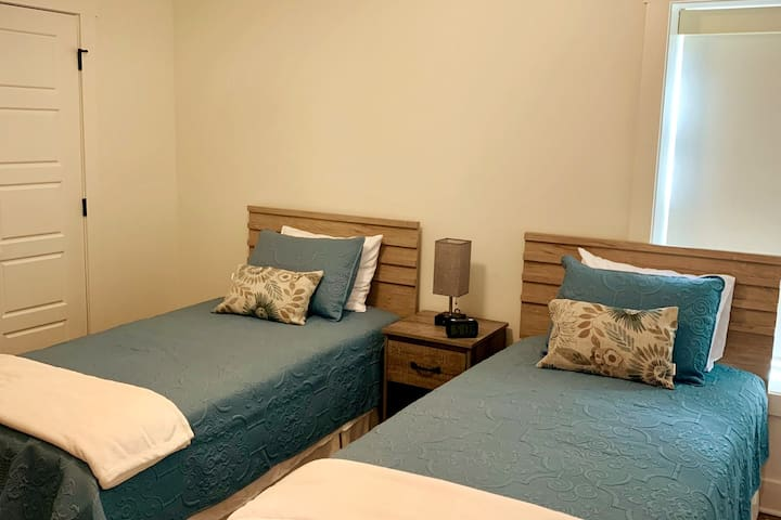 Two X-long twin beds, plus full closet and dresser.