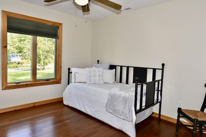 1st floor - Twin bedroom (with rollout Trundle Bed).   Located directly across the hallway from the 1st floor Queen bedroom.
