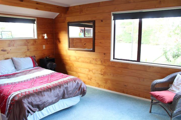 Double bed in here, but an additional single or fold out double couch can be added.  French doors lead to pool area and garden.