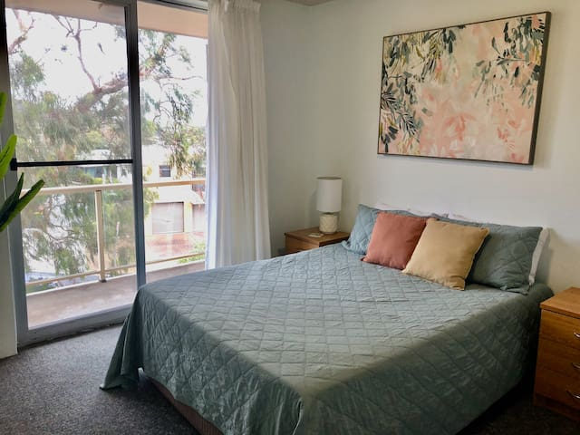 Master bedroom with queen bed with balcony