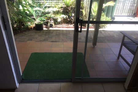 Patio sliding door entry width is 90cm, there is a small step over door frame