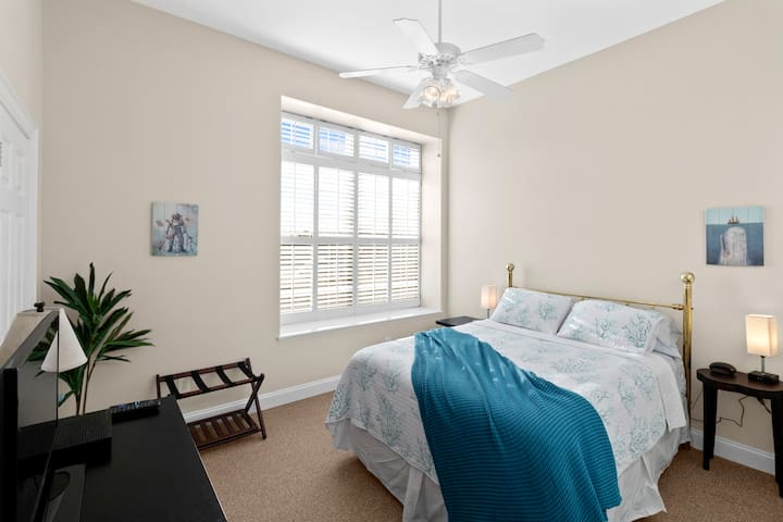 Second bedroom with plush queen bed and walk-in closet