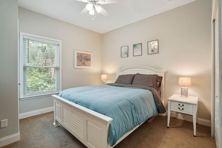 Queen bed with two end tables and two large closets. Iron, ironing board, and hair dryer are included.