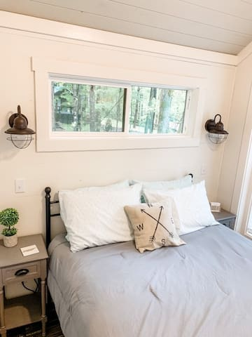 Master bedroom includes a queen bed, multiple pillows to choose from, two night lights, end tables with USB port to charge your phone.