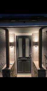 2 Porch lights to front door and security light to the side door