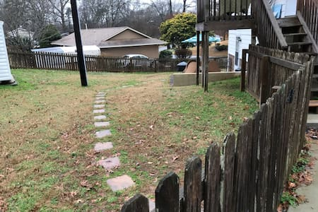 """Note the pole to the left is a 24-hour """"street lamp"""" to allow for a well-lit path. Entry does require crossing a grassy area over a stone path."""