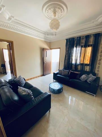 Louange with a  3 seater & 2 seater sofas, large screen tv, wifi, cable tv with access to a private balcony. Salon equipé de 2 canapés de 3 & 2 places avec une télé à écran large, wifi, télé cablée  avec accès sur un balcon privé.