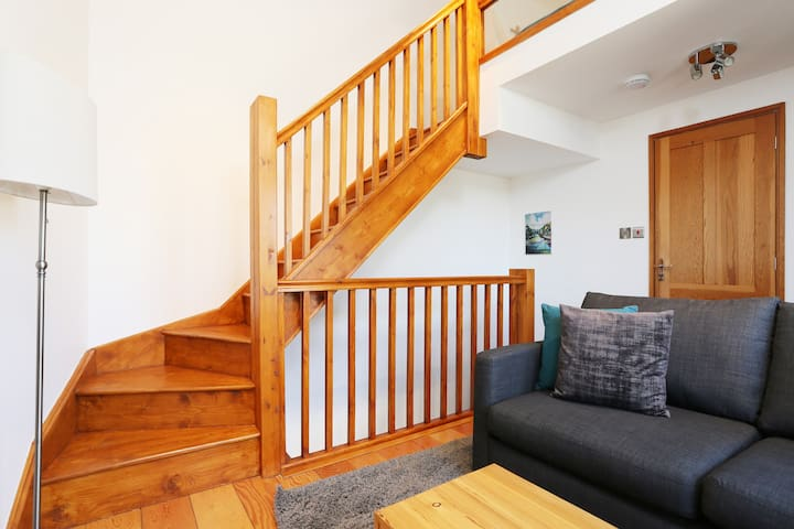 Upstairs to mezzanine bed deck, or through the door to the shower room...