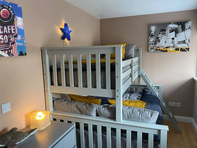 Second Bedroom - Our triple sleeper bed has a full size double bed and above it a standard single bed.   Please note the maximum age for the single bed is 12 years old.