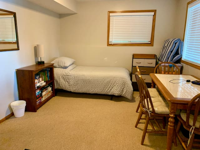 Basement living room: 2 twin beds and a futon chair that opens into a single bed. There is also a free standing gas stove and a door to the backyard. This room does not have a privacy door but a drape is available to place in the doorway for privacy.